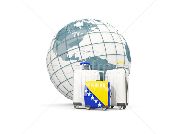 Equipaje bandera tres bolsas frente mundo Foto stock © MikhailMishchenko