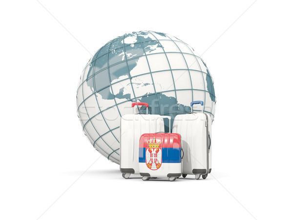 Luggage with flag of serbia. Three bags in front of globe Stock photo © MikhailMishchenko