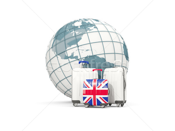 Luggage with flag of united kingdom. Three bags in front of glob Stock photo © MikhailMishchenko