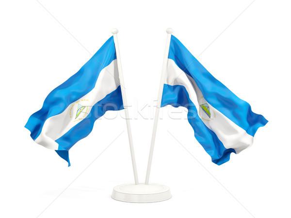 Kettő integet zászlók Nicaragua izolált fehér Stock fotó © MikhailMishchenko