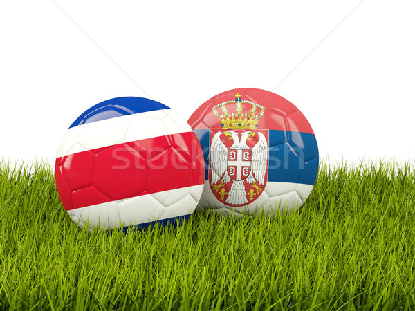 Costa Rica vs Serbia. Soccer concept. Footballs with flags on gr Stock photo © MikhailMishchenko