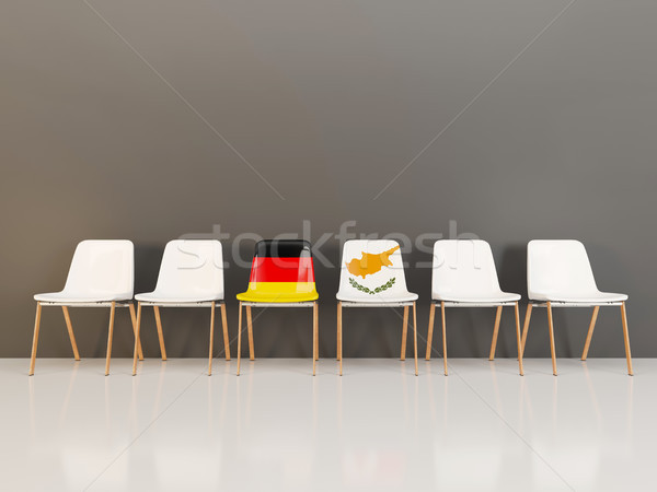 Chairs with flag of Germany and cyprus in a row Stock photo © MikhailMishchenko