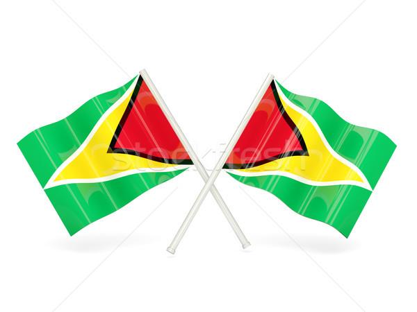 Vlag Guyana twee golvend vlaggen geïsoleerd Stockfoto © MikhailMishchenko