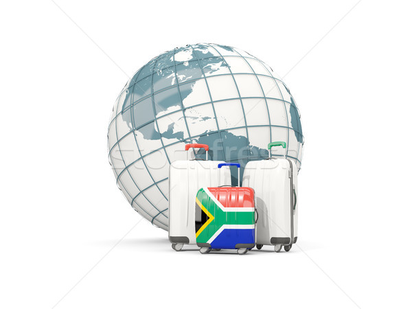 Luggage with flag of south africa. Three bags in front of globe Stock photo © MikhailMishchenko