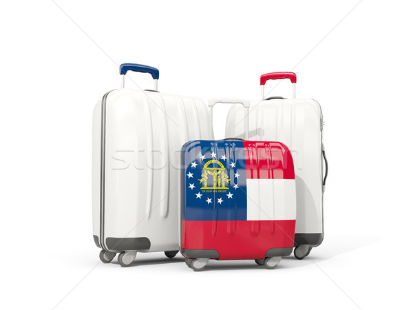 Luggage with flag of georgia. Three bags with united states loca Stock photo © MikhailMishchenko