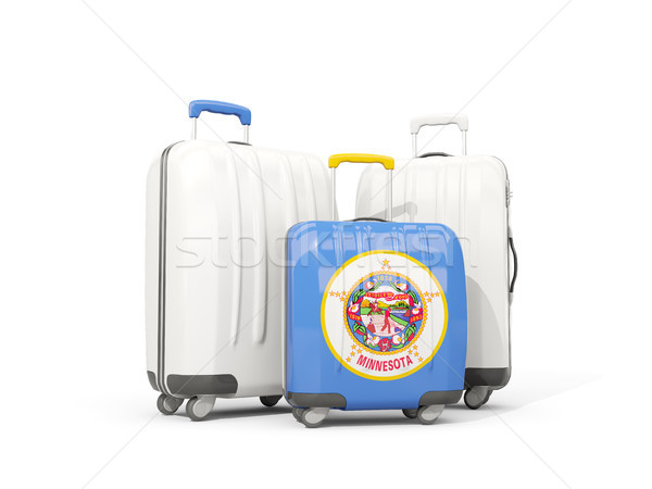 Luggage with flag of minnesota. Three bags with united states lo Stock photo © MikhailMishchenko