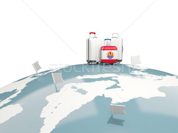 Luggage with flag of french polynesia. Three bags on top of glob Stock photo © MikhailMishchenko