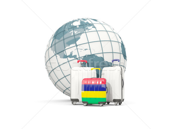 Luggage with flag of mauritius. Three bags in front of globe Stock photo © MikhailMishchenko