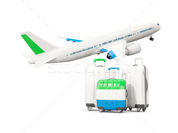 Luggage with flag of sierra leone. Three bags with airplane Stock photo © MikhailMishchenko
