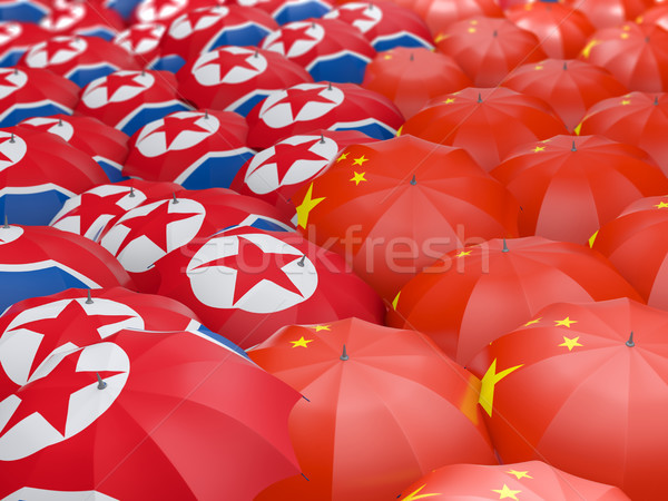 Flags of China and North Korea on umbrellas Stock photo © MikhailMishchenko