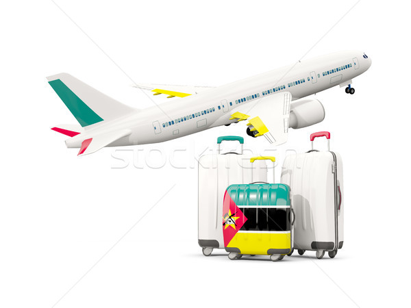 Luggage with flag of mozambique. Three bags with airplane Stock photo © MikhailMishchenko