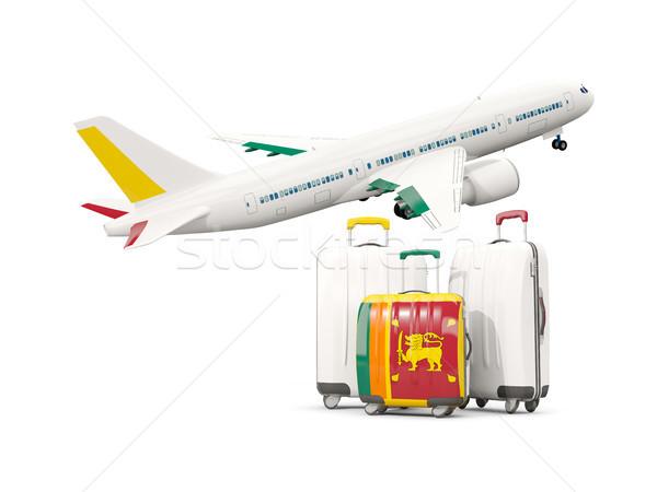 Luggage with flag of sri lanka. Three bags with airplane Stock photo © MikhailMishchenko