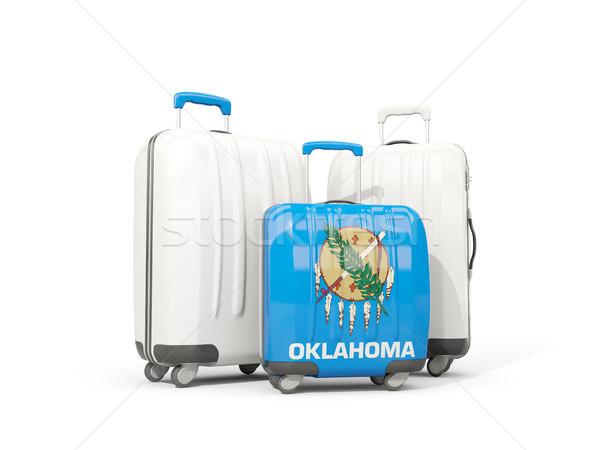 Luggage with flag of oklahoma. Three bags with united states loc Stock photo © MikhailMishchenko