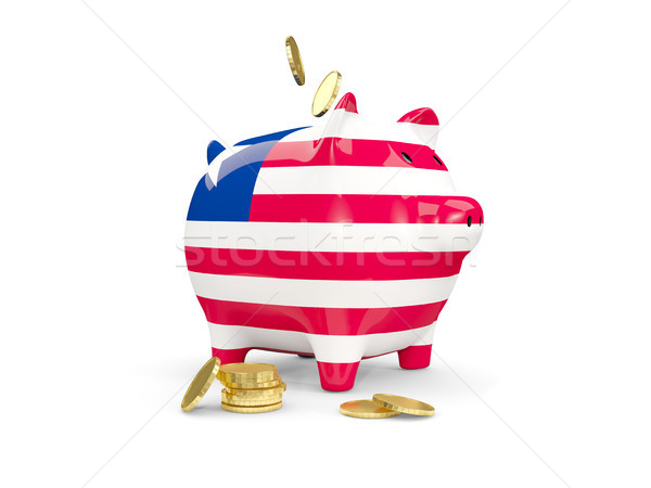 Fat piggy bank with fag of liberia Stock photo © MikhailMishchenko