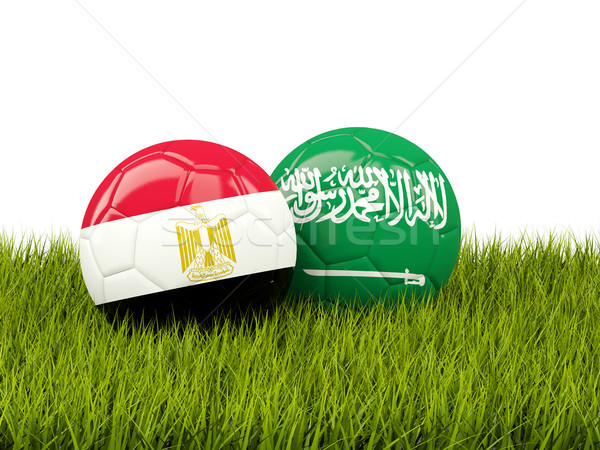 Stock photo: Egypt vs Saudi Arabia. Soccer concept. Footballs with flags on g