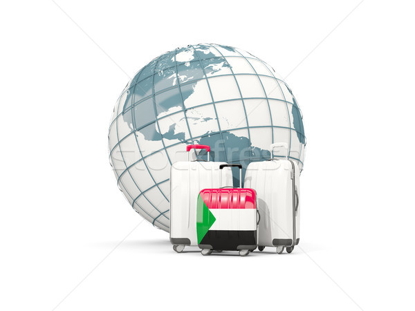 Luggage with flag of sudan. Three bags in front of globe Stock photo © MikhailMishchenko