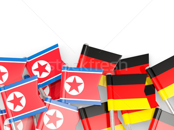 Flag pins of North Korea (DPRK) and Germany isolated on white Stock photo © MikhailMishchenko