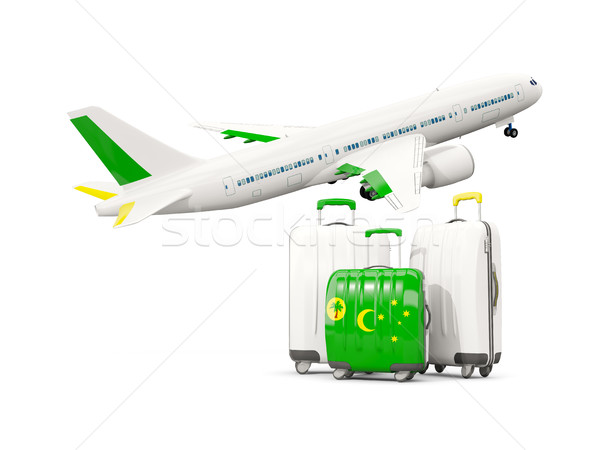 Luggage with flag of cocos islands. Three bags with airplane Stock photo © MikhailMishchenko