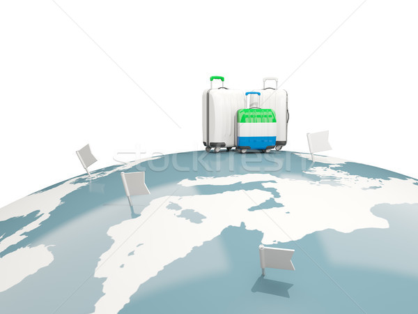 Luggage with flag of sierra leone. Three bags on top of globe Stock photo © MikhailMishchenko