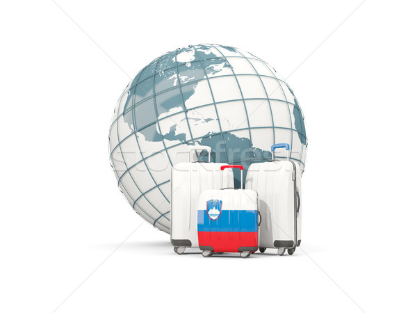 Luggage with flag of slovenia. Three bags in front of globe Stock photo © MikhailMishchenko