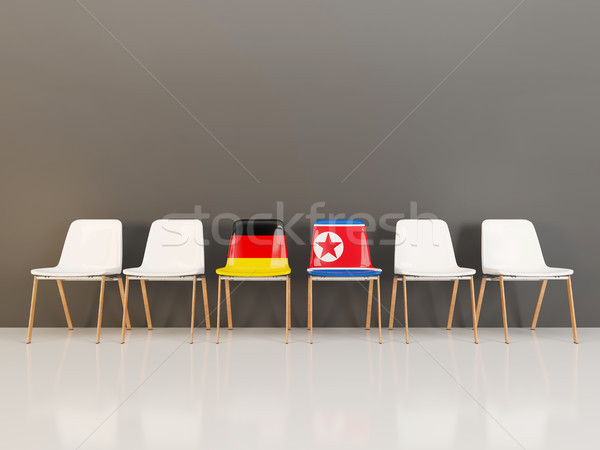 Chairs with flag of Germany and north korea in a row Stock photo © MikhailMishchenko