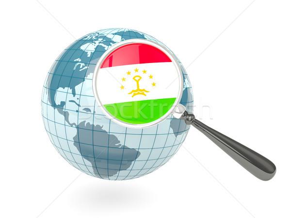 Magnified flag of tajikistan with blue globe Stock photo © MikhailMishchenko