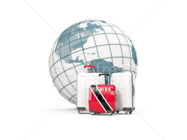Luggage with flag of trinidad and tobago. Three bags in front of Stock photo © MikhailMishchenko