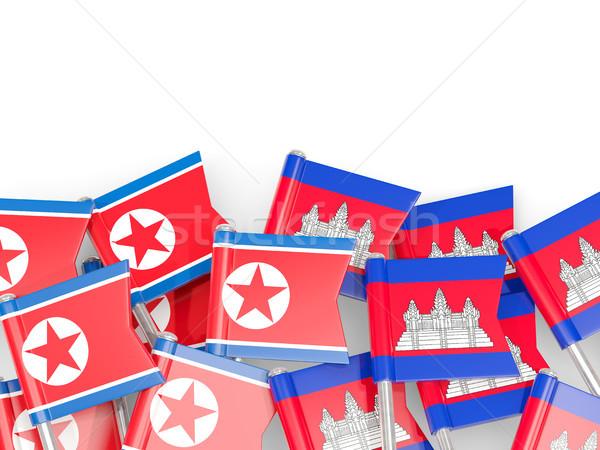 Flag pins of North Korea (DPRK) and Cambodia isolated on white Stock photo © MikhailMishchenko