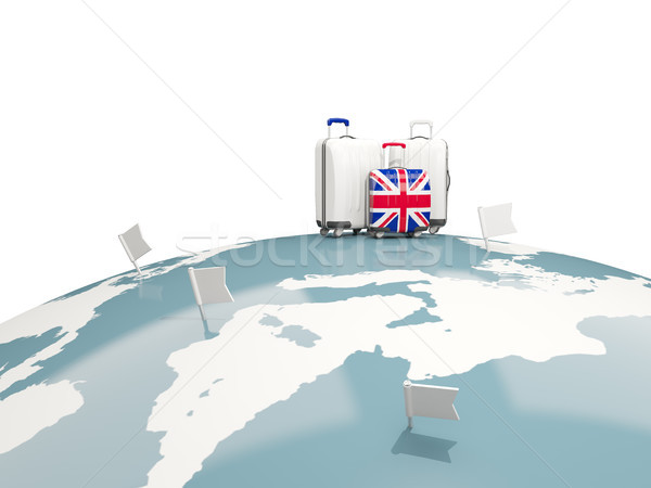Stock photo: Luggage with flag of united kingdom. Three bags on top of globe