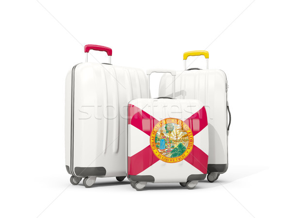 Luggage with flag of florida. Three bags with united states loca Stock photo © MikhailMishchenko