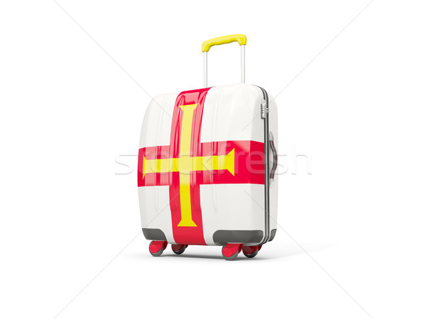 Luggage with flag of guernsey. Suitcase isolated on white Stock photo © MikhailMishchenko