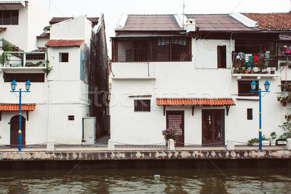 Old colonial buildungs close to water canal in Malacca Stock photo © MikhailMishchenko