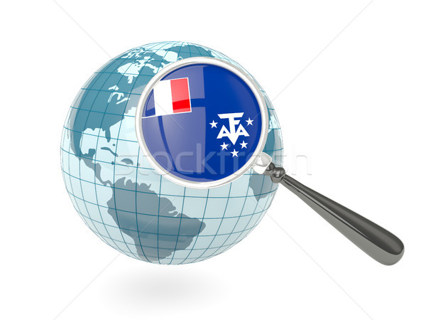 Magnified flag of french southern territories with blue globe Stock photo © MikhailMishchenko