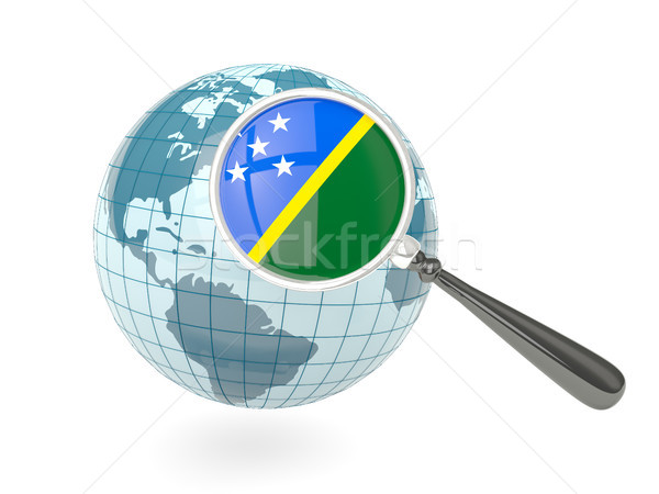 Magnified flag of solomon islands with blue globe Stock photo © MikhailMishchenko