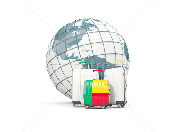 Luggage with flag of benin. Three bags in front of globe Stock photo © MikhailMishchenko