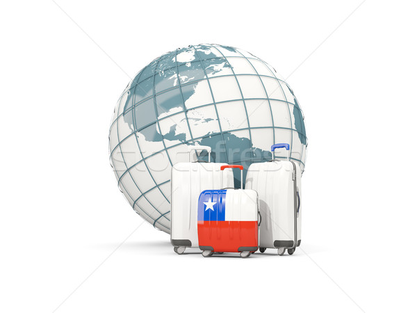 Luggage with flag of chile. Three bags in front of globe Stock photo © MikhailMishchenko