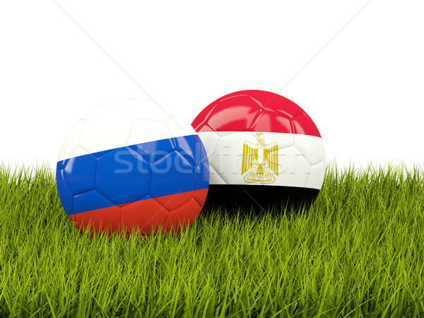 Russia vs Egypt. Soccer concept. Footballs with flags on green g Stock photo © MikhailMishchenko