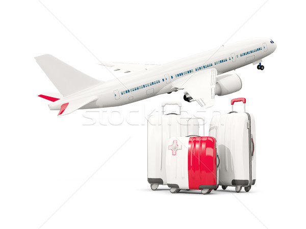 Luggage with flag of malta. Three bags with airplane Stock photo © MikhailMishchenko