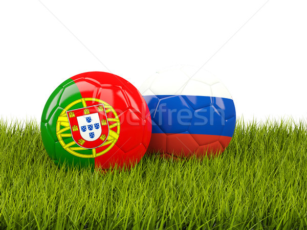 Two footballs with flags of Portugal and Russia on green grass Stock photo © MikhailMishchenko