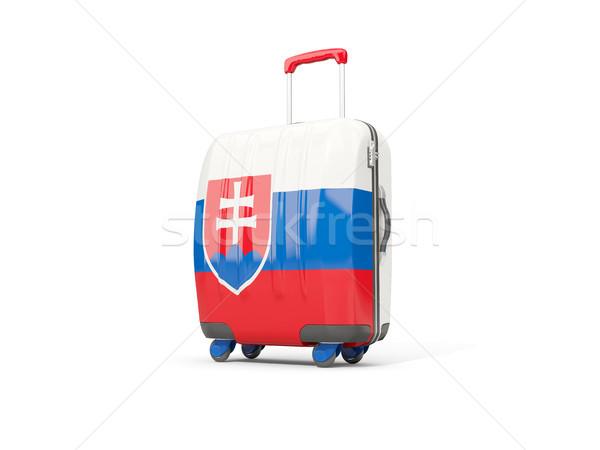 Luggage with flag of slovakia. Suitcase isolated on white Stock photo © MikhailMishchenko