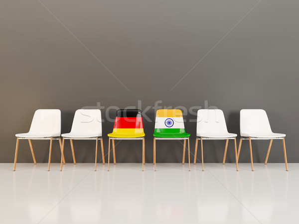 Chairs with flag of Germany and india in a row Stock photo © MikhailMishchenko