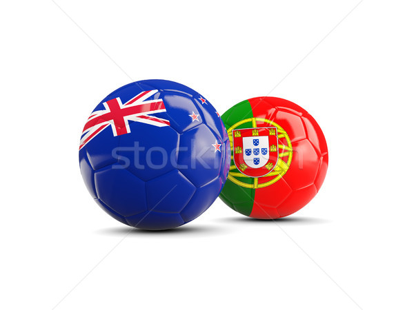 Two footballs with flags of New Zealand and Portugal isolated on Stock photo © MikhailMishchenko
