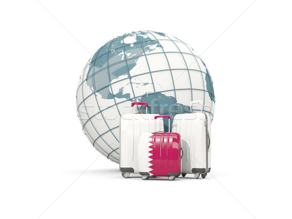 Luggage with flag of qatar. Three bags in front of globe Stock photo © MikhailMishchenko