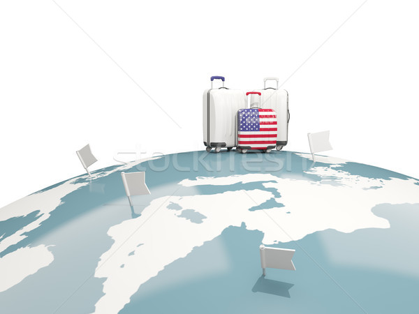 Luggage with flag of united states of america. Three bags on top Stock photo © MikhailMishchenko
