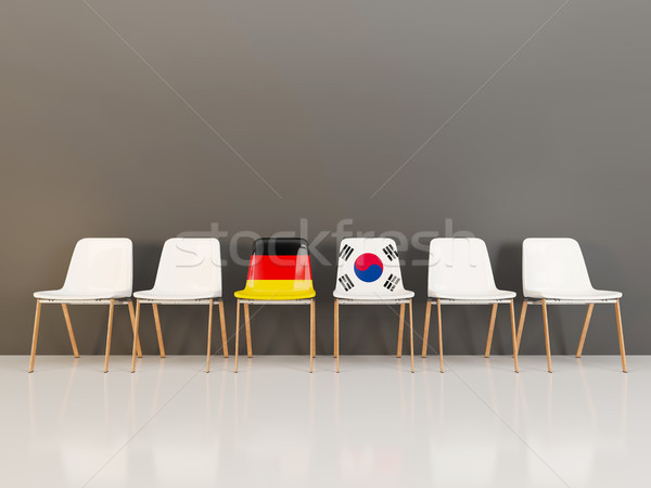 Chairs with flag of Germany and south korea in a row Stock photo © MikhailMishchenko