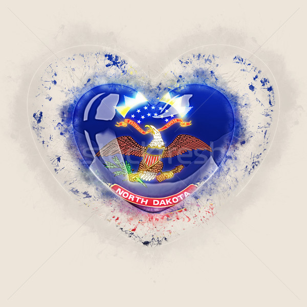 north dakota state flag on a grunge heart. United states local f Stock photo © MikhailMishchenko