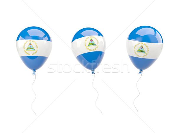 Air balloons with flag of nicaragua Stock photo © MikhailMishchenko