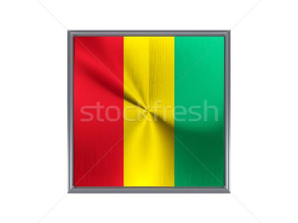 Placu metal przycisk banderą Gwinea odizolowany Zdjęcia stock © MikhailMishchenko