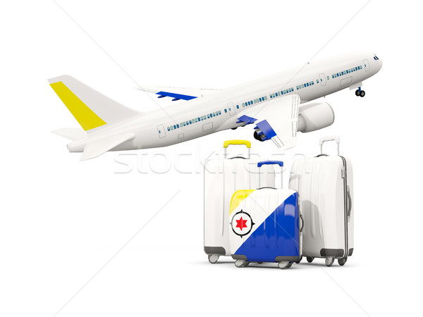 Luggage with flag of bonaire. Three bags with airplane Stock photo © MikhailMishchenko