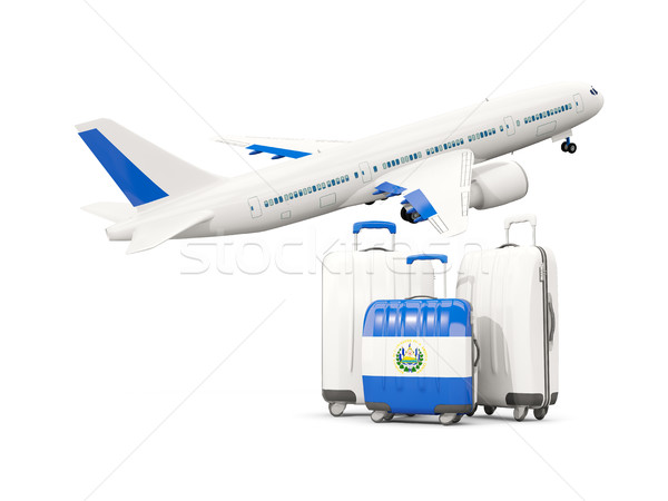 Luggage with flag of el salvador. Three bags with airplane Stock photo © MikhailMishchenko